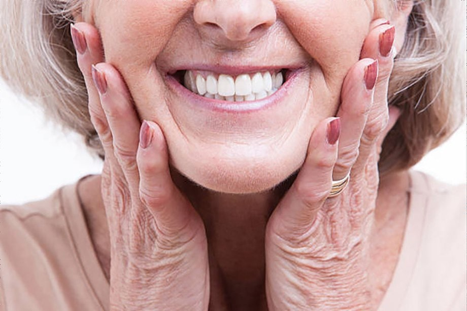 Should I Get Dentures or Implants to Replace My Missing Teeth?